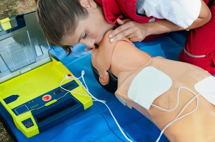 CPR training with defibrillatior on DPR doll