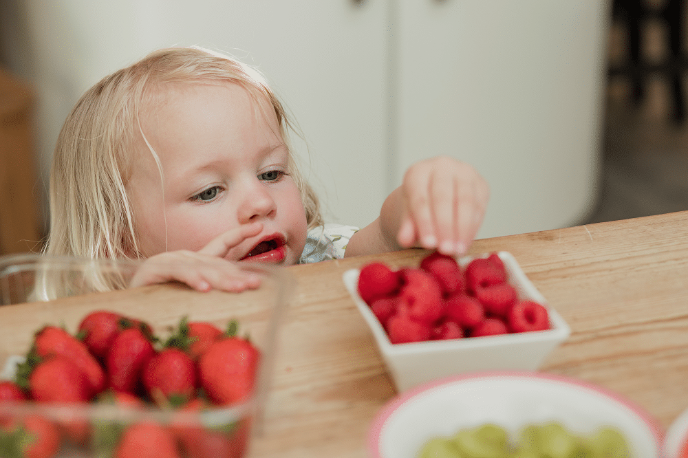 Child with raspberries